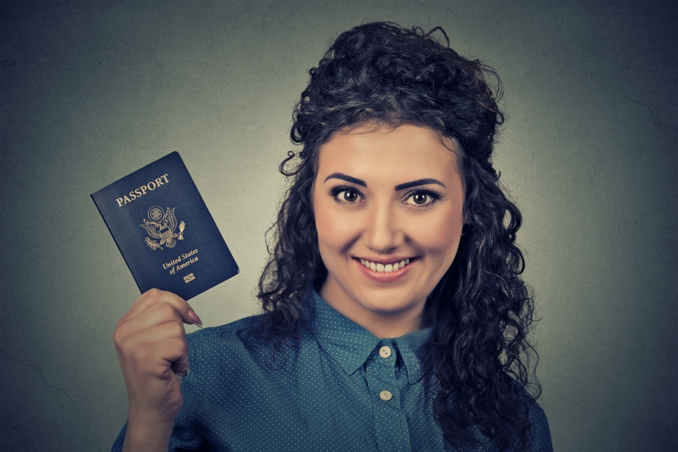 young excited woman with USA passport